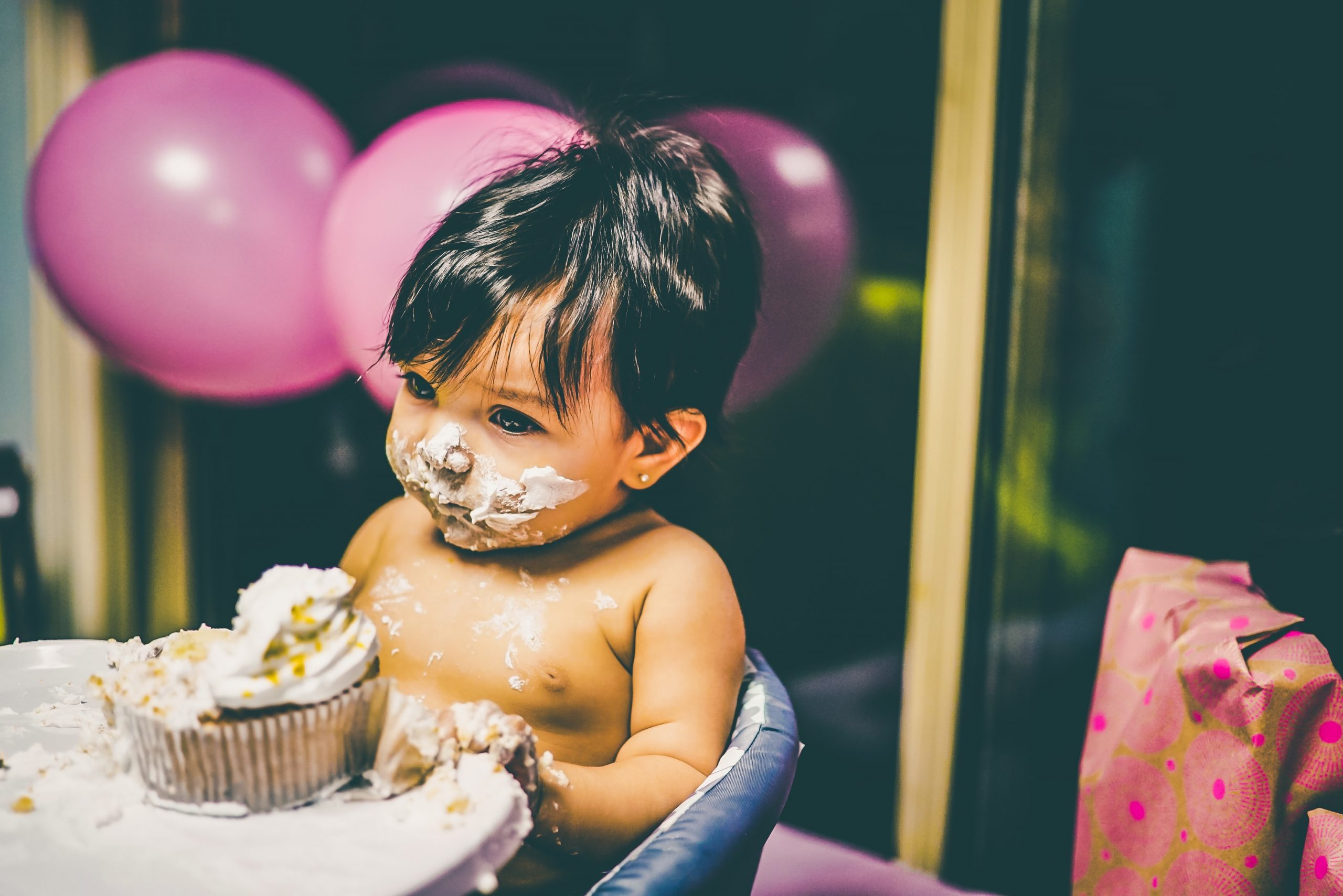 child with cake on face scaled