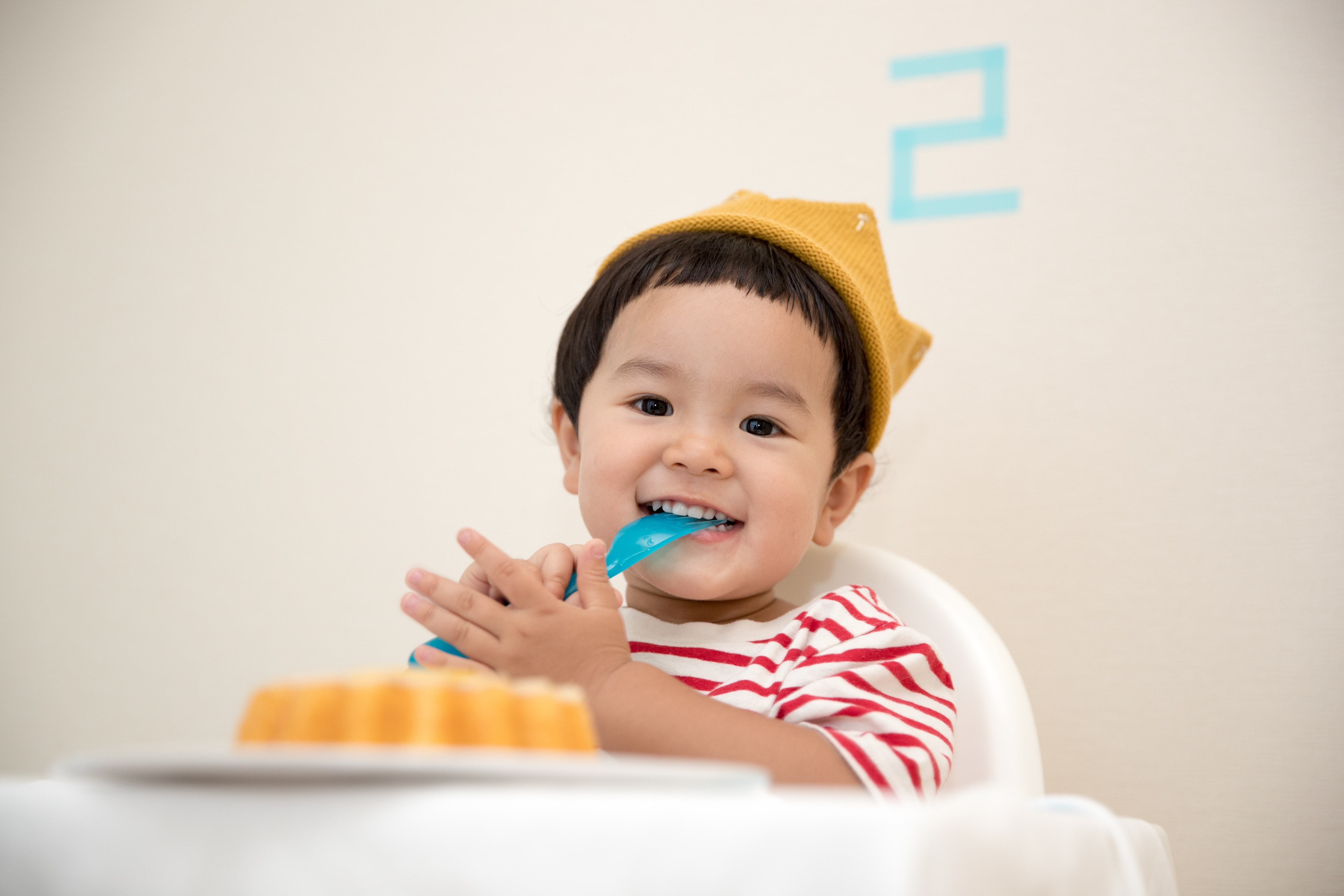 toddler with fork in mouth